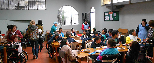 A volunteer teaching in an indigenous school in Quito