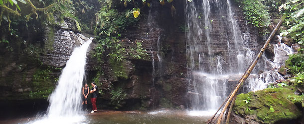 waterfall in teh Amazon jungle near a Shuar community where volunteers can bathe